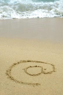 "photo: ""@"" symbol in sand"